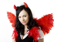 Girl in a devil costume with a gift. Picture of a girl in a devil costume with a gift stock images