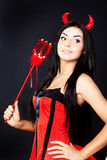 Girl devil holds the magic wand. Beautiful skinny girl devil holds the magic wand Royalty Free Stock Photography
