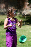 Girl with diabolo. Girl with painted face exerts a Diabolo Royalty Free Stock Photography