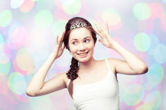 Girl in a diadem. Beautiful girl admiring her diamond tiara Stock Image