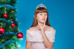 The girl with a diadem on the head costs near an elegant New Yea Stock Images