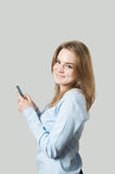Girl dialing on cell phone Royalty Free Stock Images