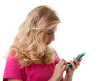 Girl is dialing on mobile phone Stock Image