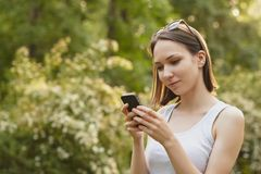 Girl dials the number Stock Photography