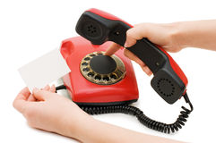 The girl dials number on red phone Royalty Free Stock Photo