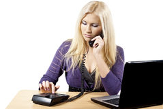 Girl dials the phone Stock Photography