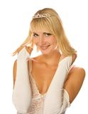 Girl with diamond diadem. Beautiful blond girl with diamond diadem on her head isolated on white background Royalty Free Stock Photos