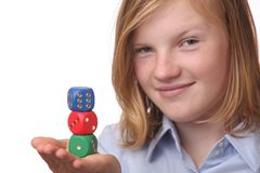Girl with dices Stock Image