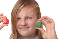 Girl with dices Royalty Free Stock Photography