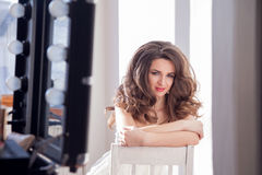 The girl did makeup and hairstyle. Curls Stock Image