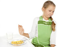 Girl did not want to eat cereal and milk. Little girl did not want to eat cereal and milk Royalty Free Stock Image