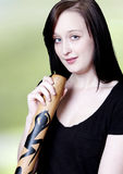 Girl with Didgeridoo. A young woman holds a didgeridoo Royalty Free Stock Images