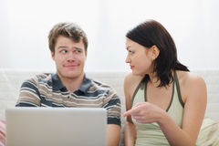 Girl didnt like what she saw in boyfriends laptop Stock Image