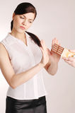 Girl on diet. Doesn`t eat chocolate Stock Photos