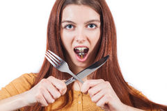 Girl on diet. Girl hold crossed knife and fork in hands and weight in mouse. Concept of diet Royalty Free Stock Images