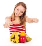 Girl on a diet, joy fruit Royalty Free Stock Photo