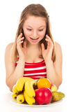 Girl on a diet, joy fruit Stock Images