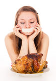 The girl on a diet, and want to eat meat Stock Photography
