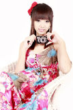 Girl with digital camera Stock Image