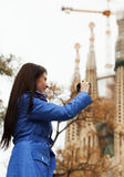 Girl with digital camera photographing Stock Photos
