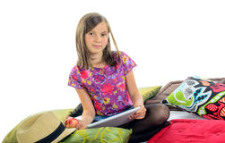 Girl with a digital tablet and an apple Royalty Free Stock Images