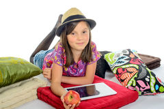 Girl with a digital tablet and an apple Stock Images
