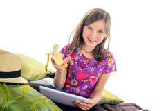 Girl with a digital tablet and an banana Royalty Free Stock Photography
