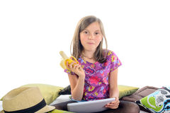 Girl with a digital tablet and banana Royalty Free Stock Photos