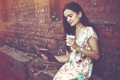 Girl with digital tablet and coffee royalty free stock photography