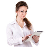 Girl with a digital tablet in hands smiling isolated on white Stock Images