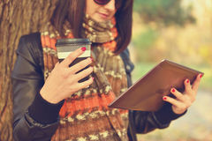 Girl with digital tablet Stock Images