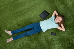 Girl With Digital Tablet And Mobile Phone Royalty Free Stock Photography
