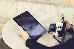Girl with digital tablet and old camera Royalty Free Stock Photography