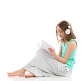 Girl with a digital tablet Stock Images