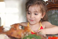 Girl at dining table Royalty Free Stock Image
