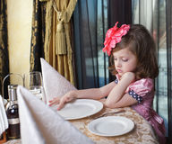 Girl at the dinner table Stock Image