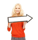 Girl with direction arrow sign Stock Images