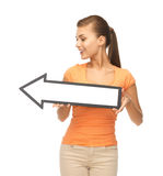 Girl with direction arrow sign Royalty Free Stock Photos