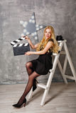 Girl director with an empty clapperboard Stock Images