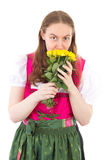 Girl in dirndl with bunch of yellow roses. Beautiful girl in dirndl with bunch of yellow roses Royalty Free Stock Photos