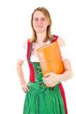 Girl in dirndl carrying orange ring binder Royalty Free Stock Image