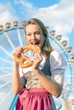 Girl with dirndl does oktoberfest wiesn in munic. Young woman is doing oktoberfest in munic bavaria in the spring summer autumn folk festival. she is wearing a stock photo