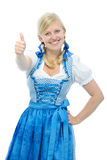 Girl in dirndl holding thumbs up Stock Photo