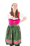 Girl in dirndl pointing at you Stock Photos