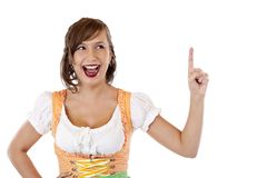 Girl in dirndl points with finger at ad space Royalty Free Stock Photos