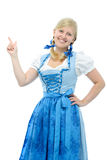 Girl in dirndl points her finger upwards Stock Images