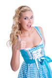 Girl in dirndl thumbs up Royalty Free Stock Images