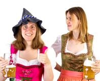Girl in dirndl wearing Seppelhut showing thumb up Stock Photo