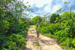 Girl on dirt road. Girl photographer on a dirt road among the green plants Stock Photos