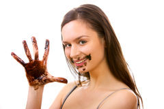 Girl dirty in chocolate Stock Images